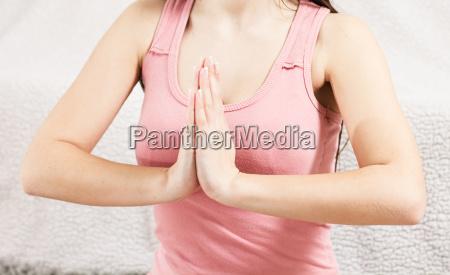 young woman doing yoga meditating relaxing