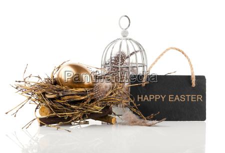 golden egg in nest with blackboard