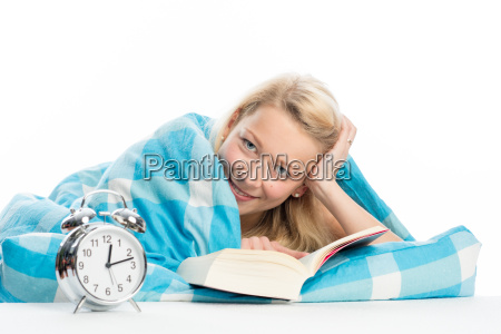 blond woman is reading a book