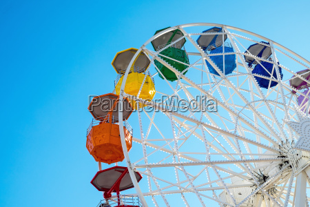 detail of a colorful ferris wheel