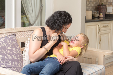 mother and daughter having fun on