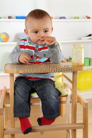 baby eating baby porridge from the