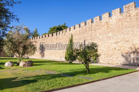 the ancient city walls of evora