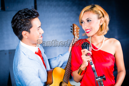 asian professional band recording song in