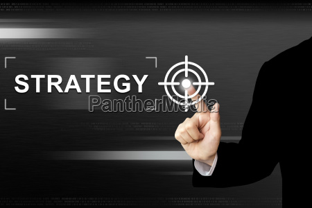 business hand pushing strategy button on