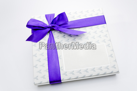 printed over a purple ribbon gift
