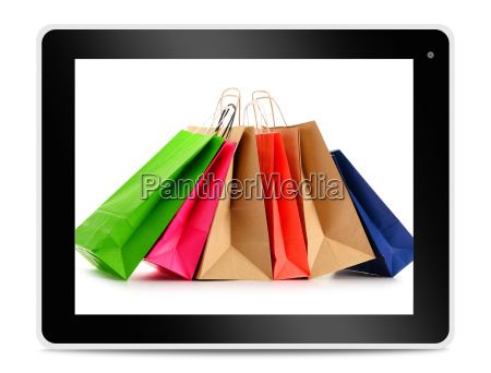 paper shopping bags on computer tablet
