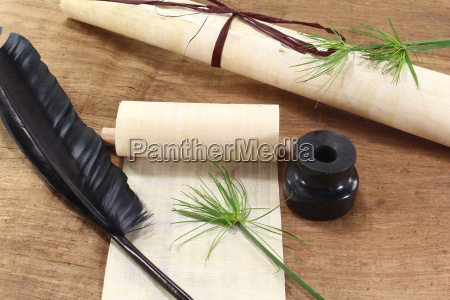 papyrus scroll with quill pen