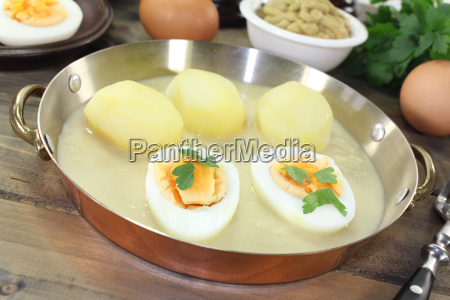 fresh mustard eggs with sauce and