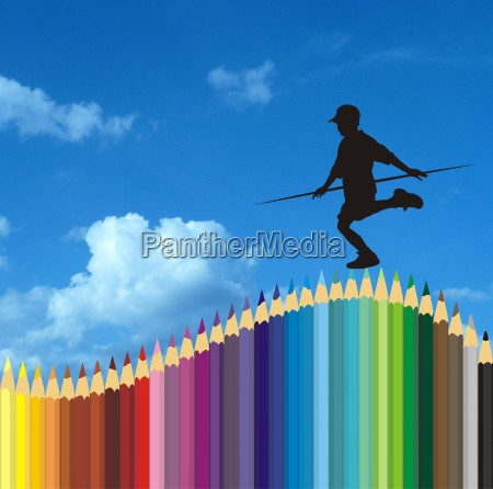 boy balancing on pencil