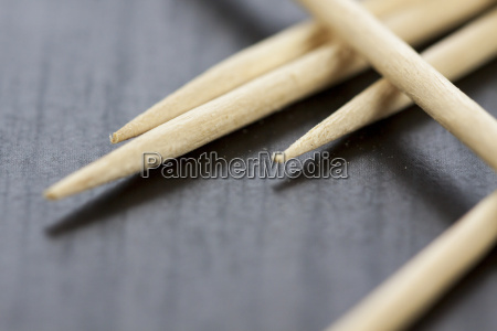 stack of wooden toothpicks as closeup