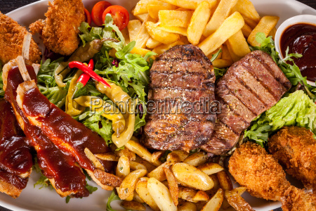 huge barbecue plate with mixed meat