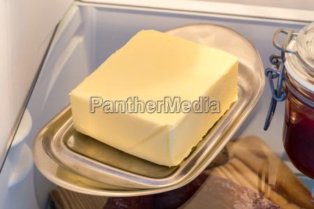 butter in fridge with open door