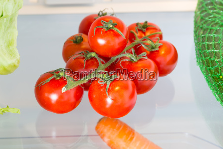 tomatoes in the fridge with the