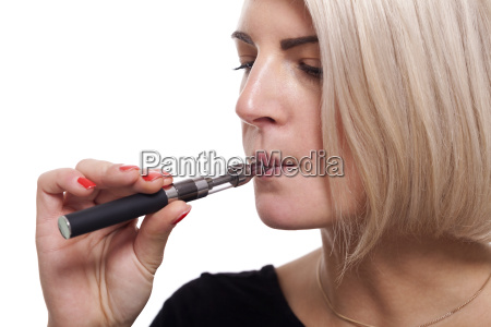 young woman smoking an e cigarette