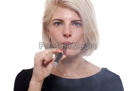 young woman smoking a e cigarette