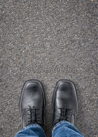 feet on street with copy space