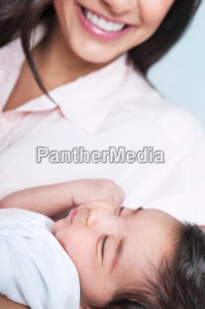 sleeping baby on mothers hands