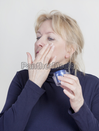 woman with wrinkle cream