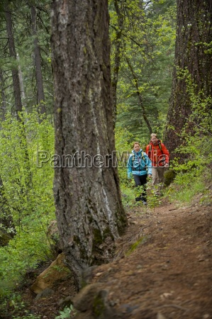 man and woman hiking in mccloud