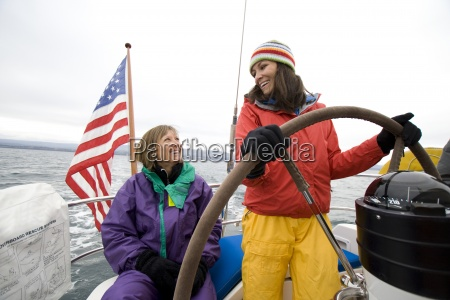 two smiling women in sailing gear