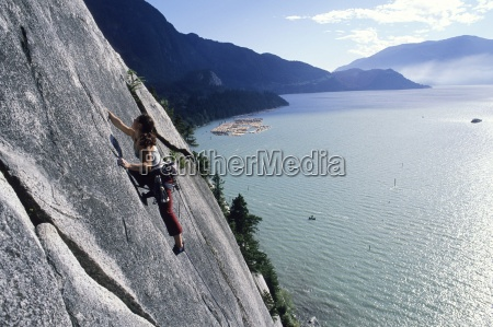 a woman rock climbing with water