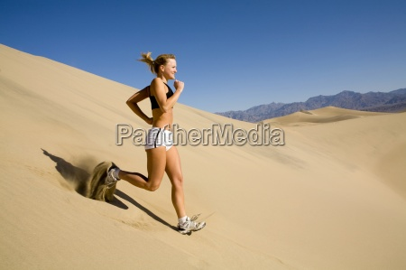 a young woman running down a