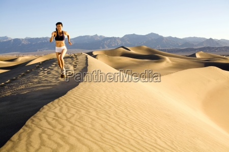 a young woman running atop the