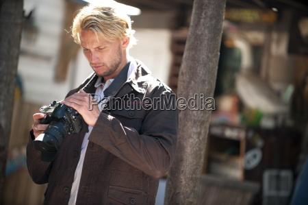 a man uses a digital camera