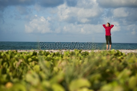 a woman meditates in everglades national