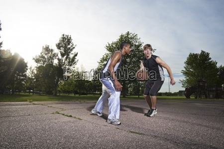 two young men play one on