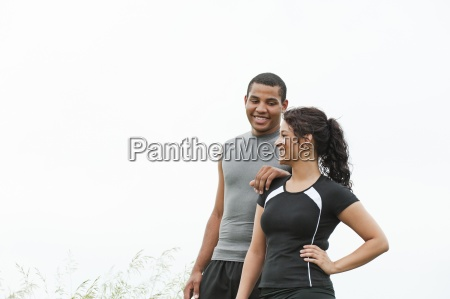 young man and woman smiling after