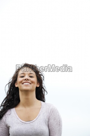 young woman with dark hair smiles