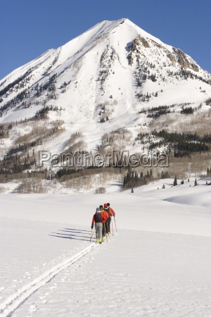 four skiers alpine touring in colorado