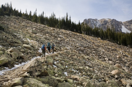 a man and two women hiking