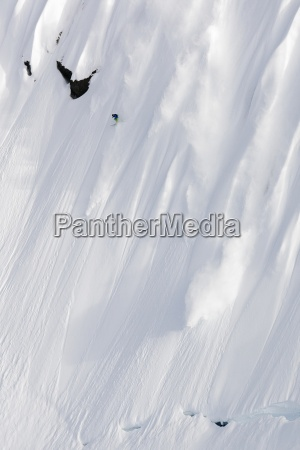 extreme skiing down a steep fluted