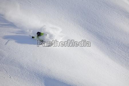 a male skier skis untracked powder