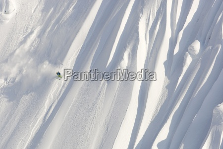 a male skier skis a huge