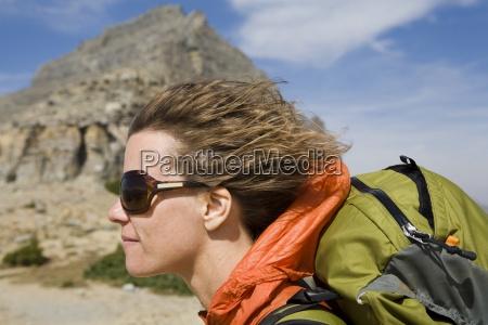 solo female backpacker enjoying a strong