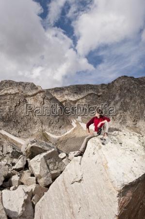 a man sits to enjoy the