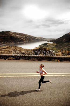 an athletic woman jogging along a