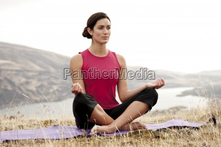a female practicing yoga in the