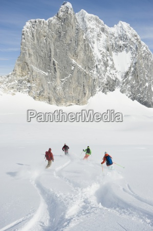 a group of backcountry skiers cross