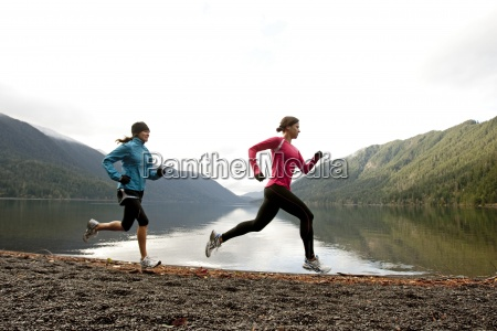 two females jogging together along the