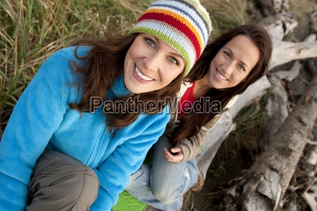 two beautiful women smile while enjoying