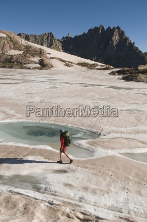 a woman hiking on still frozen