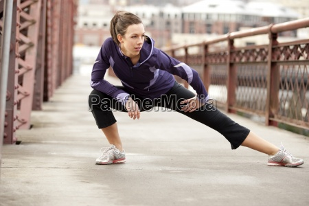 an athletic female in a purple