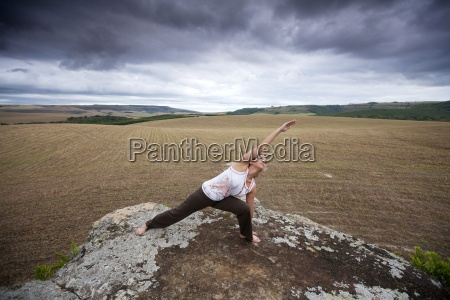a woman practices yoga in a