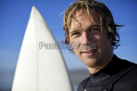 young male surfer with wet hair