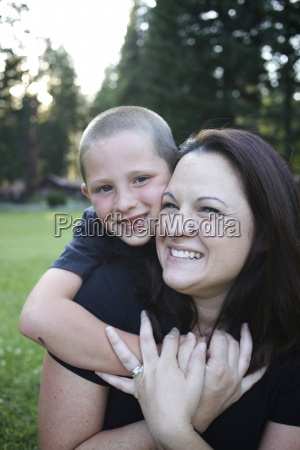 young boy hugs his mom